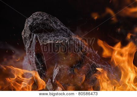 Coal lumps with fire flames, close-up