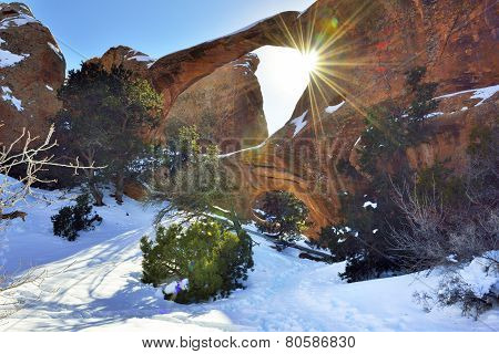 Sun Rays Coming Through The Double-o-arch In Devil's Garden In Arches National Park, Utah In Winter,