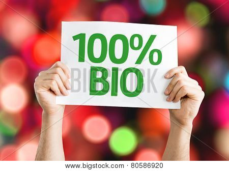 100% Bio card with colorful background with defocused lights