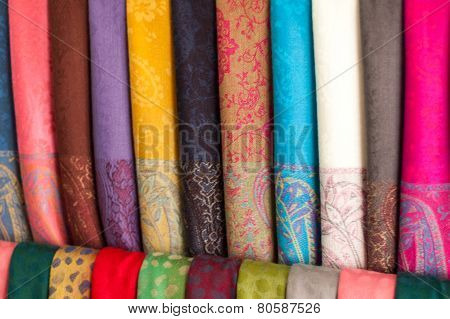 Rows Of Different Brightly Colored Fabrics