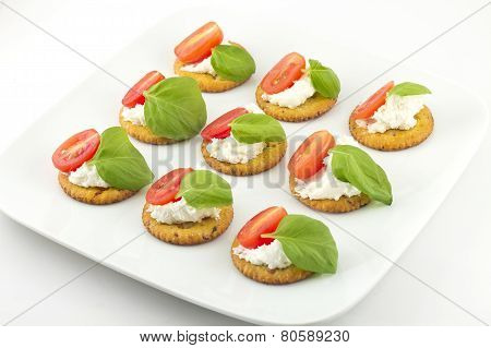 Crackers With Cheese Tomato And Basil