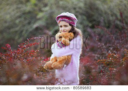 Female child hugging her teddy bear