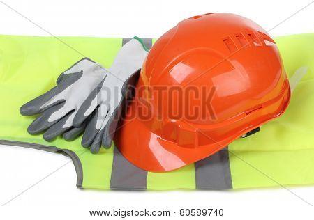 Orange construction helmet and gloves on white background