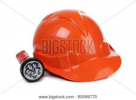 Orange construction helmet and lantern on white background