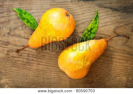 Yellow Pears On Wooden Background