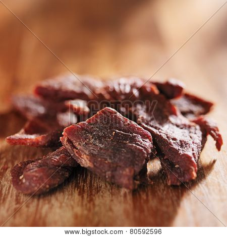 pile of beef jerky on wooden table