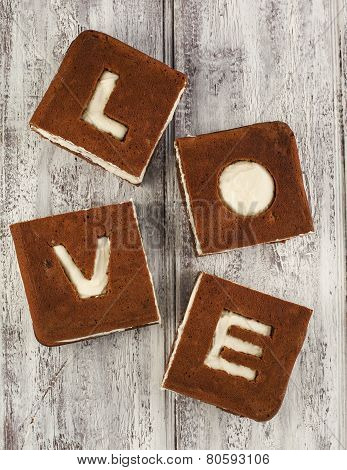 Love Cake. Chocolate Banana Cake With Cream cheese Frosting And Word Love.