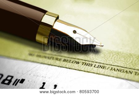 Gold Fountain Pen And Cheque