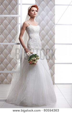A photo of sexual beautiful bride in a wedding-dress is in fashion style. Wedding decorations