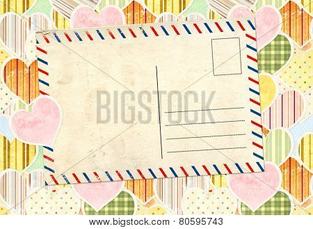 Valentine background with paper hearts and old post card