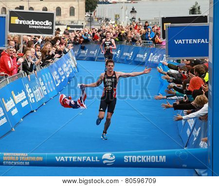 Jonathan Brownlee With Flag - Finish