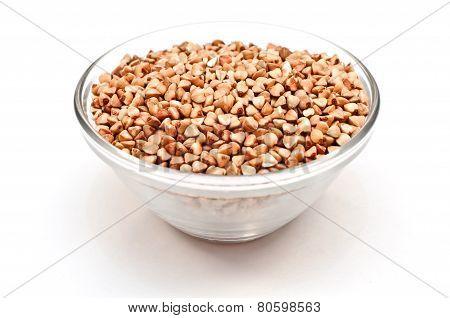 raw buckwheat groats in plate