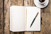 stock photo of fountains  - Notebook with elegant fountain pen and cup of espresso - JPG
