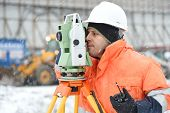 stock photo of inspection  - Surveyor at construction site is inspecting ongoing works in difficult winter conditions - JPG