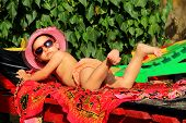 pic of sunbather  - rest with the child - JPG