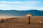 stock photo of bromo  - Sign to mount Bromo at plateau east Java Indonesia - JPG