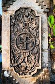 image of swastika  - Detail of hindu temple with swastika symbol Indonesia - JPG