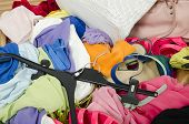 image of untidiness  - Untidy cluttered wardrobe with colorful clothes and accessories - JPG