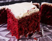 picture of red velvet cake  - A slice of red velvet cake with cream cheese frosting ready to be eaten - JPG