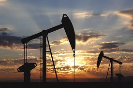 foto of gas-pipes  - Oil pump oil rig energy industrial machine for petroleum in the sunset background - JPG