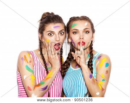 Two Surprised Smeared In Paint Girl Friends