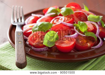 healthy tomato salad with onion basil olive oil and balsamic vinegar
