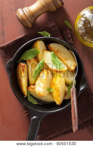 baked potato wedges in black frying pan