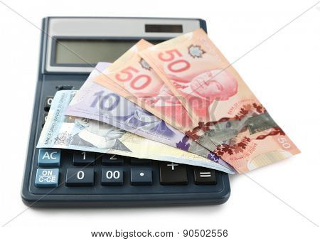 Calculator and Canadian dollars, isolated on white