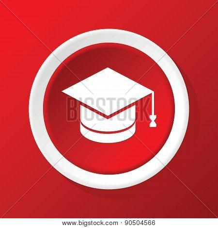 Academic hat icon on red