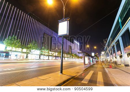 illuminated bus stop and street