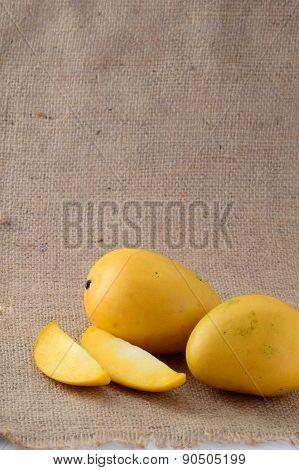 Mango fruit with slice on sack cloth