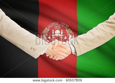 Businessmen Handshake With Flag On Background - Afghanistan
