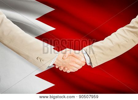 Businessmen Handshake With Flag On Background - Bahrain