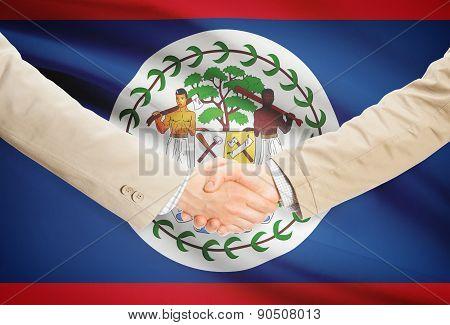 Businessmen Handshake With Flag On Background - Belize
