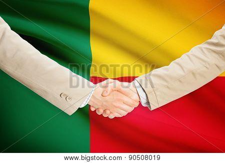 Businessmen Handshake With Flag On Background - Benin
