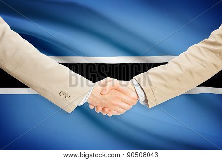 Businessmen Handshake With Flag On Background - Botswana