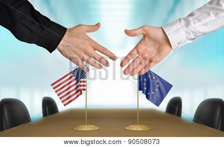 United States and European Union diplomats agreeing on a deal
