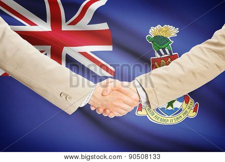 Businessmen Handshake With Flag On Background - Cayman Islands