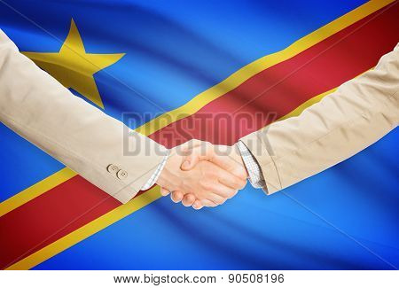 Businessmen Handshake With Flag On Background - Democratic Republic Of The Congo - Congo-kinshasa