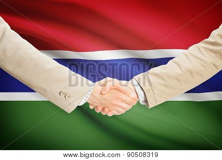 Businessmen Handshake With Flag On Background - Gambia