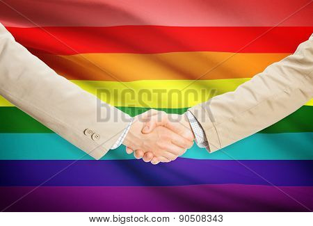 Businessmen Handshake With Flag On Background - Lgbt People