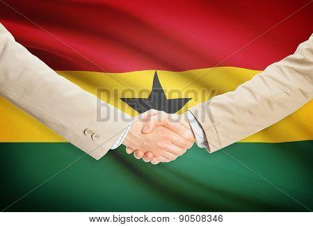 Businessmen Handshake With Flag On Background - Ghana