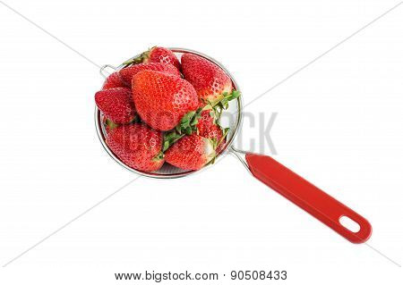 Fresh strawberries in small colander, isolated over white