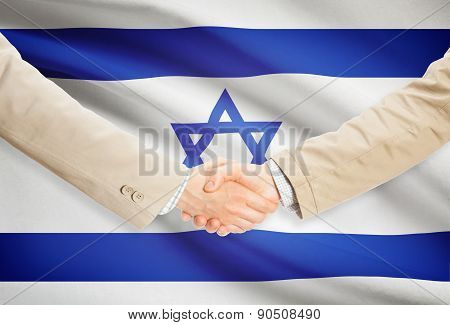 Businessmen Handshake With Flag On Background - Israel