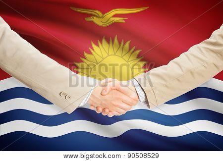 Businessmen Handshake With Flag On Background - Kiribati