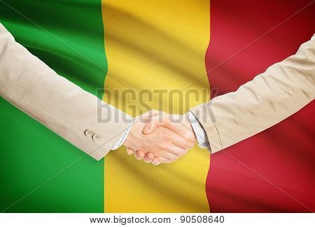 Businessmen Handshake With Flag On Background - Mali