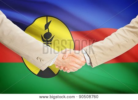 Businessmen Handshake With Flag On Background - New Caledonia