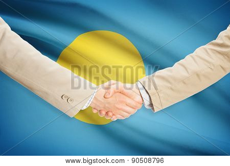 Businessmen Handshake With Flag On Background - Palau