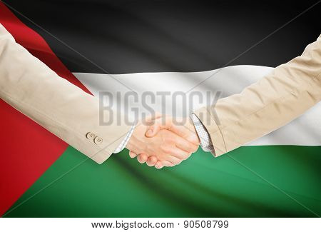 Businessmen Handshake With Flag On Background - Palestine