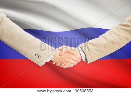 Businessmen Handshake With Flag On Background - Russia